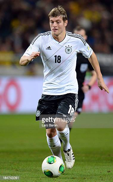 Toni Kroos ofGermany runs with the ball during the FIFA 2014 World Cup Qualifying Group C match between Sweden and Germany at Friends Arena Solna on...