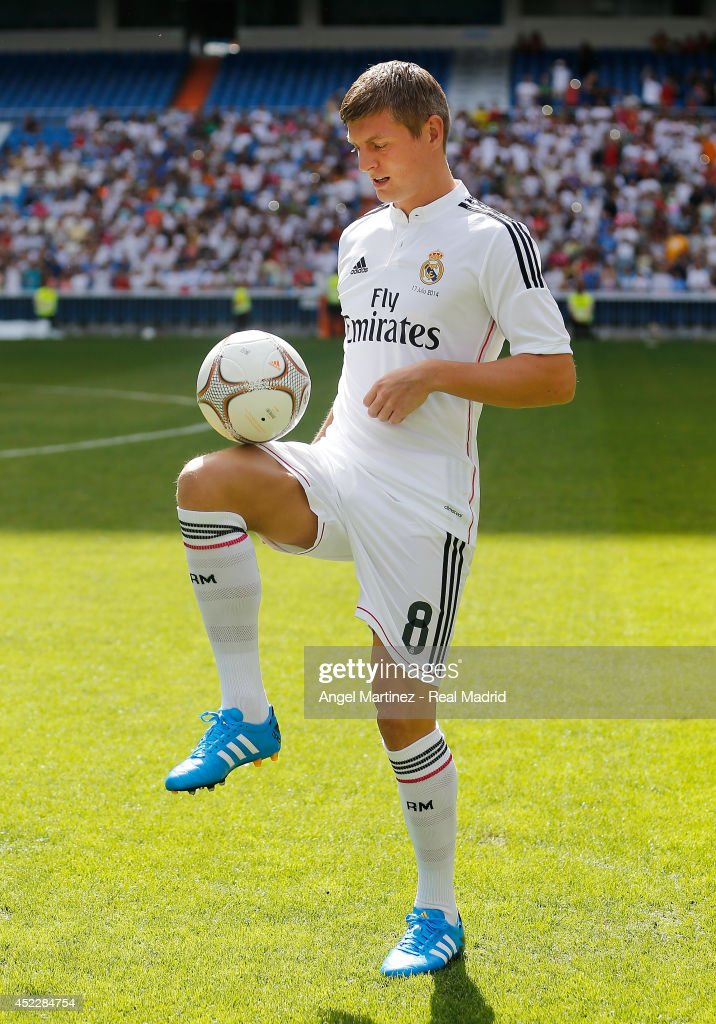 Toni Kroos plays with the ball during his official unveiling as a new Real Madrid player at Estadio Santiago Bernabeu on July 17, 2014 in Madrid, Spain.