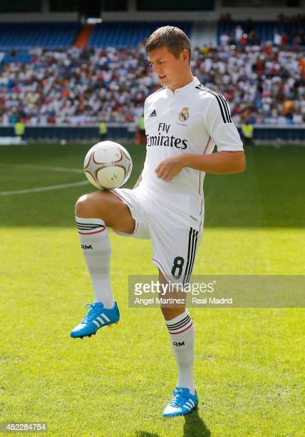 Toni Kroos plays with the ball during his official unveiling as a new Real Madrid player at Estadio Santiago Bernabeu on July 17 2014 in Madrid Spain
