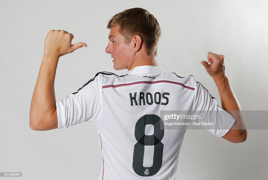 Toni Kroos poses during his official unveiling as a new Real Madrid player at Estadio Santiago Bernabeu on July 17, 2014 in Madrid, Spain.