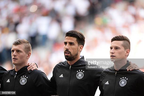 Toni Kroos Sami Khedira and Julian Draxler of Germany during the European Championship match Round of 16 between Germany and Slovakia at Stade...