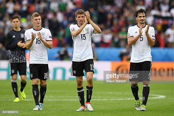 Toni Kroos Thomas Mueller and Mats Hummels of Germany applaud after their team's 10 win in the UEFA EURO 2016 Group C match between Northern Ireland...