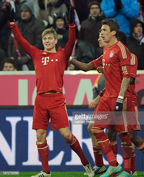 Toni Kroos Thomas Mueller David Alaba and Mario Mandzukic of Muenchen celebrate a goal during the Bundesliga match between FC Bayern Muenchen and...