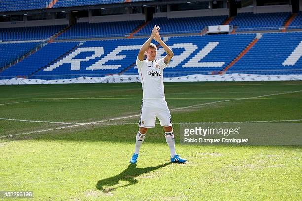 Toni Kroos waves to fans in his new Real Madrid shirt during his official  unveiling at d8b88feaf