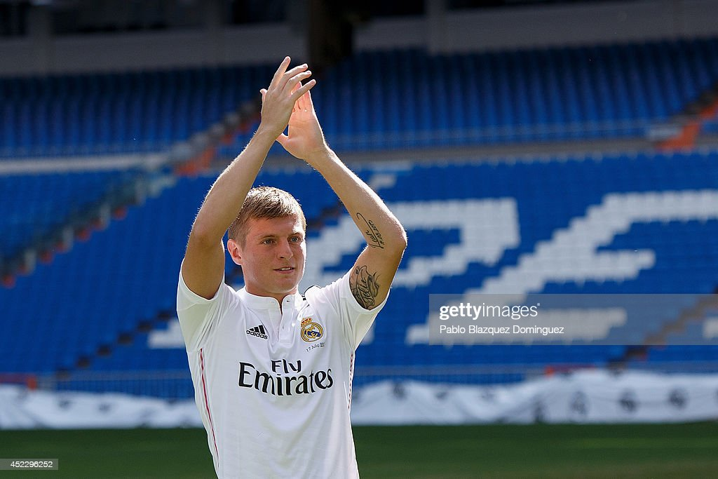 Toni Kroos waves to fans in his new Real Madrid shirt during his ... e889cdada
