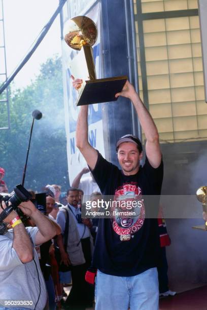 Toni Kukoc of the Chicago Bulls holds up the Larry O'Brien NBA Championship Trophy during the 1998 Chicago Bulls Celebration Rally on June 16 1998 at...
