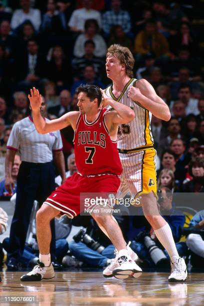 Toni Kukoc of the Chicago Bulls posts up against Rik Smits of the Indiana Pacers on March 17 1998 at Market Square Arena in Indianapolis Indiana NOTE...