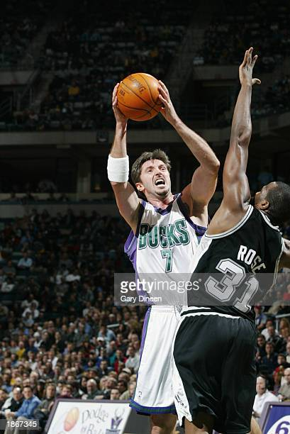 Toni Kukoc of the Milwaukee Bucks shoots over Malik Rose of the San Antonio Spurs during the game at Bradley Center on March 11 2003 in Milwaukee...