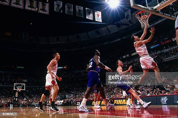Toni Kukoc of the Utah Jazz shoots a layup against Adam Keefe of the Utah Jazz in Game Five of the 1998 NBA Finals at the United Center on June 12...