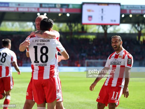 Toni Leistner, Kenny Prince Redondo and Akaki Gogia of 1 FC Union Berlin celebrate after scoring the 1:1 during the match between Union Berlin and 1....