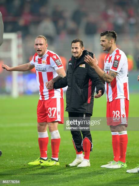 Toni Leistner Steven Skrzybski and Christopher Trimmel of 1 FC Union Berlin celebrate the 50 win after the game between Union Berlin and dem 1 FC...