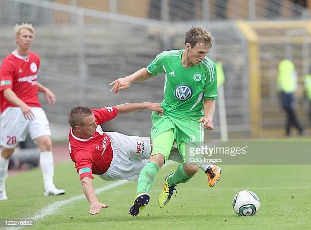 Toni Lindenhahn of Halle and Rafael Czichos of Wolfsburg fight for the ball during the Regionalliga North match between VfL Wolfsburg II and...