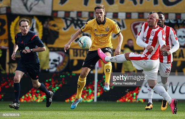 Toni Lindenhahn of Halle challenges Justin Eilers of Dresden during the Third League match between Hallescher FC and SG Dynamo Dresden at erdgas...