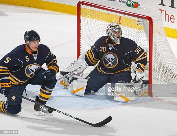Toni Lydman and Ryan Miller of the Buffalo Sabres play against the Boston Bruins in Game One of the Eastern Conference Quarterfinals during the 2010...