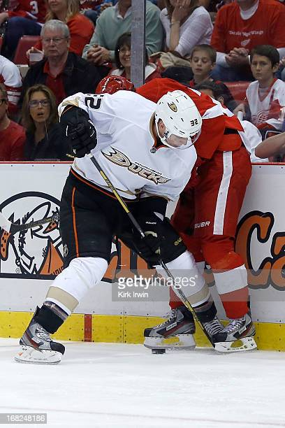 Toni Lydman of the Anaheim Ducks battles for control of the puck with Damien Brunner of the Detroit Red Wings during Game Three of the Western...