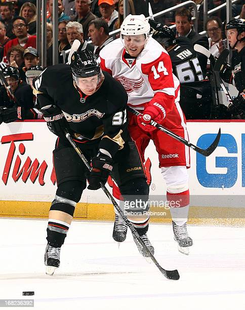 Toni Lydman of the Anaheim Ducks battles for position against Gustav Nyquist of the Detroit Red Wings in Game One of the Western Conference...