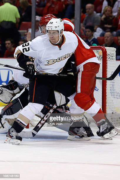 Toni Lydman of the Anaheim Ducks battles for position against Joakim Andersson of the Detroit Red Wings during Game Three of the Western Conference...