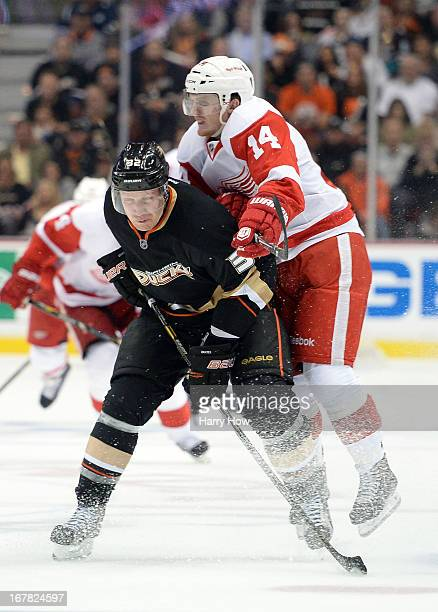 Toni Lydman of the Anaheim Ducks checks Gustav Nyquist of the Detroit Red Wings at the blue line during the second period in Game One of the Western...