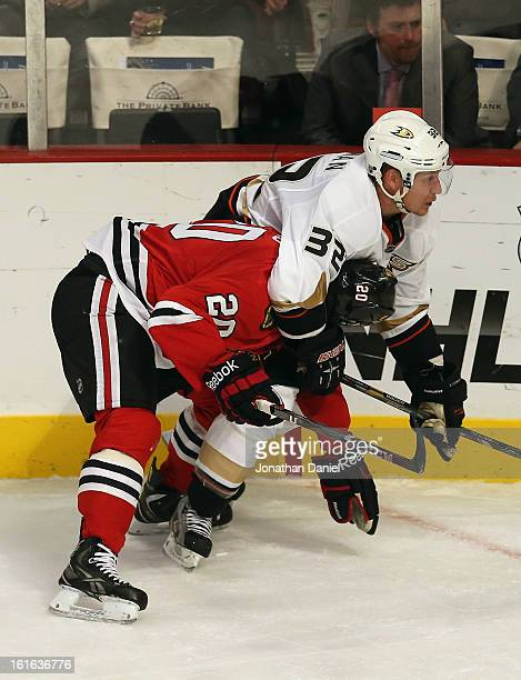 Toni Lydman of the Anaheim Ducks grabs Brandon Saad of the Chicago Blackhawks by the head at the United Center on February 12 2013 in Chicago...