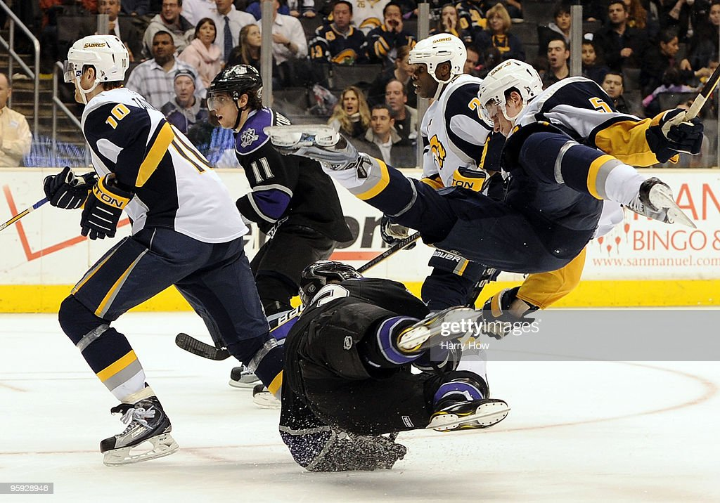 Toni Lydman #5 of the Buffalo Sabres collides with Dustin Brown #23 of the Los Angeles Kings during second period at the Staples Center on January 21, 2010 in Los Angeles, California.