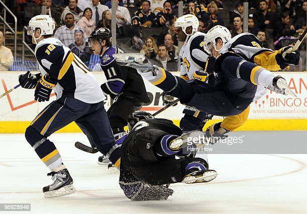 Toni Lydman of the Buffalo Sabres collides with Dustin Brown of the Los Angeles Kings during second period at the Staples Center on January 21 2010...