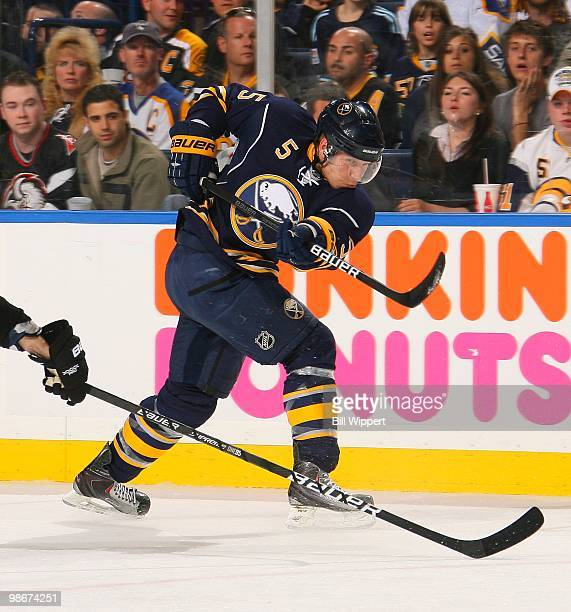 Toni Lydman of the Buffalo Sabres shoots the puck against the Boston Bruins in Game Five of the Eastern Conference Quarterfinals during the 2010 NHL...