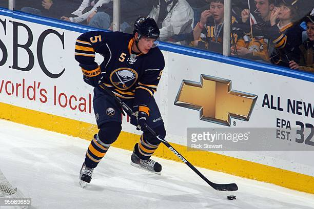 Toni Lydman of the Buffalo Sabres skates with the puck during the game against the Pittsburgh Penguins at HSBC Arena on December 29 2009 in Buffalo...