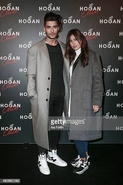 Toni Mahfud and Sylvia Haghjoo attend the HOGAN flagship boutique opening on October 15 2015 in Munich Germany