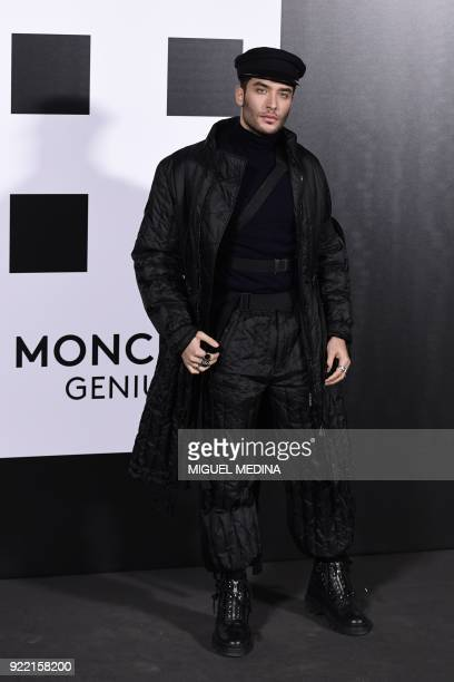 Toni Mahfud poses upon his arrival to the women's Fall/Winter 2018/2019 collection fashion show by Moncler in Milan on February 20 2018 / AFP PHOTO /...