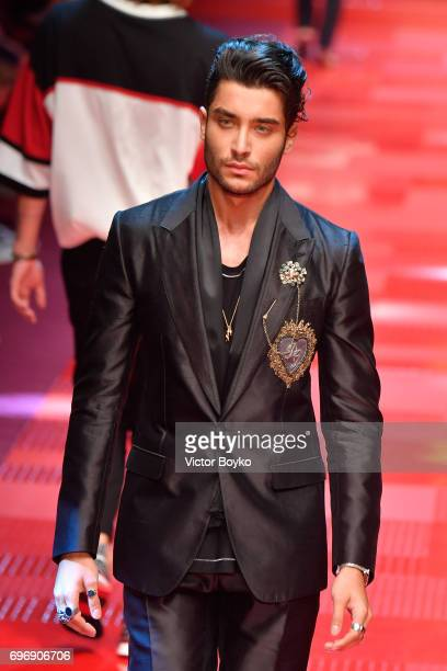Toni Mahfud walks the runway at the Dolce Gabbana show during Milan Men's Fashion Week Spring/Summer 2018 on June 17 2017 in Milan Italy