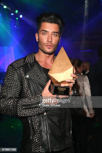 Toni Mahfud with his award during the ABOUT YOU AWARDS at the Mehr Theater in Hamburg on May 4 2017 in Hamburg Germany