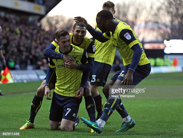 Toni Martinez of Oxford United celebrates scoring his side's third goal with his team mates during the Emirates FA Cup Fourth Round match between...