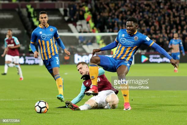 Toni Martinez of West Ham in action with Aristote Nsiala and Max Lowe of Shrewsbury Town during the Emirates FA Cup Third Round Replay match between...