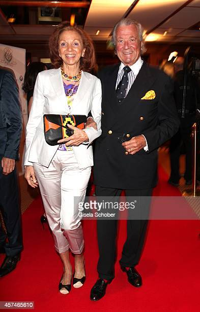 Toni Meggle and his wife Marina attend the Monti Memorial Charity Gala at Hotel Vier Jahreszeiten on October 18 2014 in Munich Germany