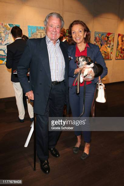 Toni Meggle and his wife Marina Meggle and dog Ali during the exhibition opening Art Coffee with artwork by artist Mauro Bergonzoli at Dinzler...