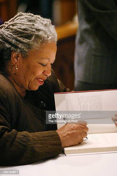 149261 Toni Morrison book signing at Metropolitan AME Church in DC PICTURED Toni Morrision signs a book for one of the many fans who came to the event