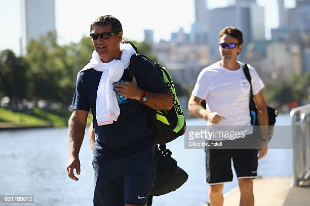 Toni Nadal and Carlos Moya coaches of Rafael Nadal of Spain relaxes as they walks along the Yarra river ahead of the 2017 Australian Open at...