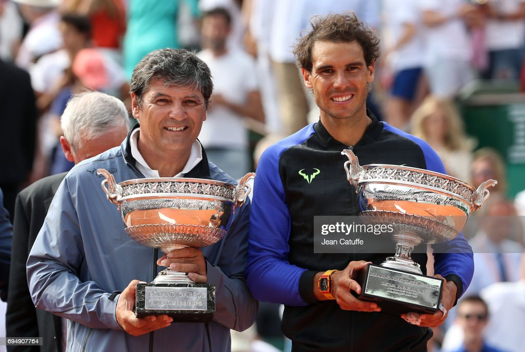 Toni Nadal and winner Rafael Nadal of Spain during the trophy ceremony following the men's final on day 15 of the 2017 French Open, second Grand Slam of the season at Roland Garros stadium on June 11, 2017 in Paris, France.