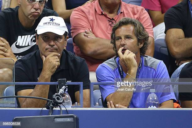 Toni Nadal coach of Rafael Nadal of Spain and assistant coach Francisco Roig look on during Rafa's second round match on day 3 of the 2016 US Open at...