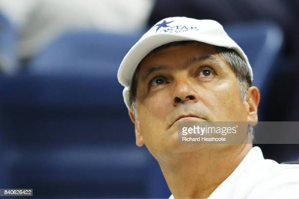 Toni Nadal watches Rafael Nadal of Spain against Dusan Lajovic of Serbia Montenegro during their first round Men's Singles match on Day Two of the...