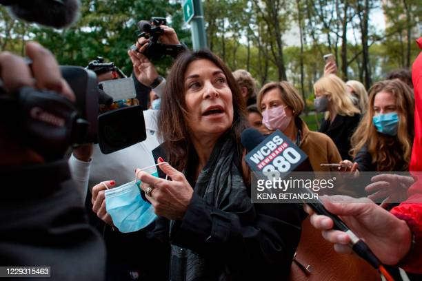 Toni Natalie, one of Keith Rainiere's ex-girlfriends and survivor of the NXIVM cult, speaks to reporters as she leaves the Brooklyn federal court...