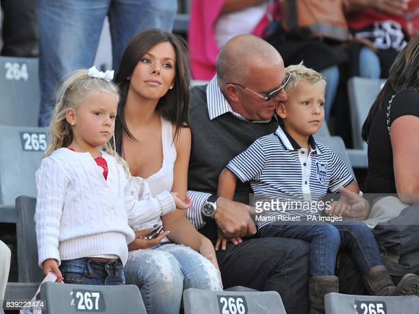 Toni Poole wife of England's John Terry sits in the stands with their two children Summer and George prior to kick off