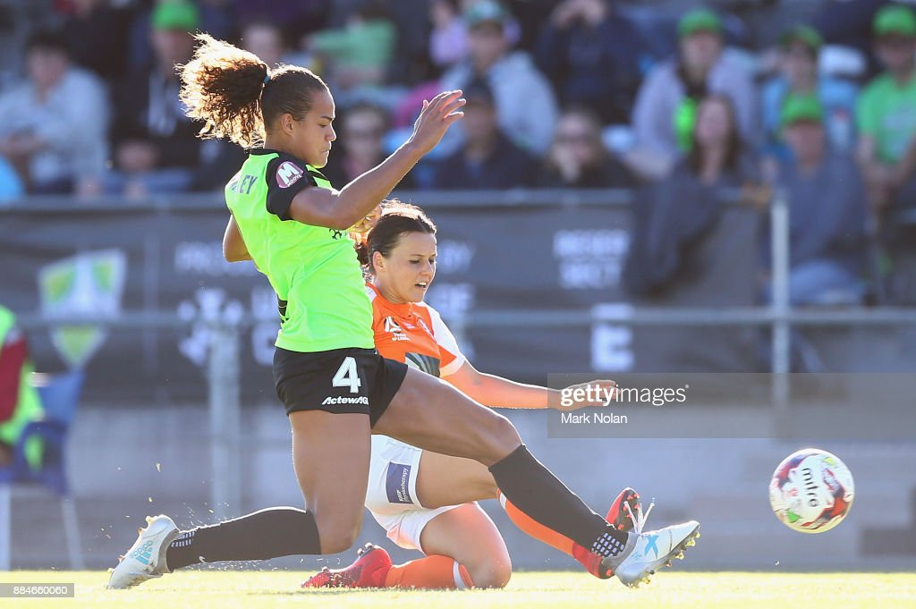 Toni Pressley of Canberra and Hayley Raso of the Roar contest possession during the round six W-League match between Canberra United and the Brisbane Roar at McKellar Park on December 3, 2017 in Canberra, Australia.