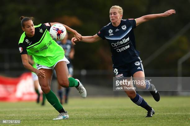 Toni Pressley of Canberra and Natasha Dowie of the Victory compete for the ball before Natasha Downie scores a goal in the second half during the...