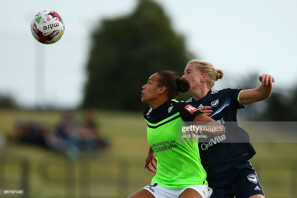 Toni Pressley of Canberra (L) and Natasha Dowie of the Victory compete for the ball before Natasha Downie scores a goal in the second half during the round one W-League match between Melbourne Victory and Canberra United at Epping Stadium on October 28, 2017 in Melbourne, Australia.