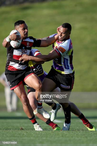 Toni Pulu of Counties is tackled by Tevita Li of North Harbour during the round eight Mitre 10 Cup match between North Harbour and Counties Manakau...
