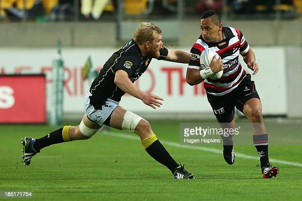 Toni Pulu of Counties Manukau is tackled by Mark Reddish of Wellington during the ITM Cup semi final match between Wellington and Counties Manukau at...