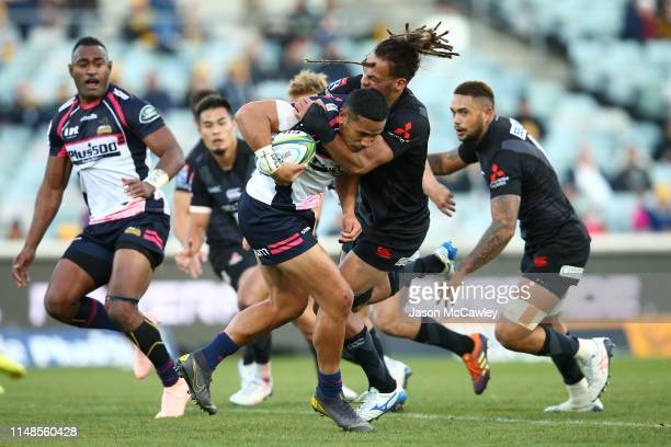 Toni Pulu of the Brumbies is tackled by Dan Pryor of the Sunwolves during the round 13 Super Rugby match between the Brumbies and Sunwolves at GIO...