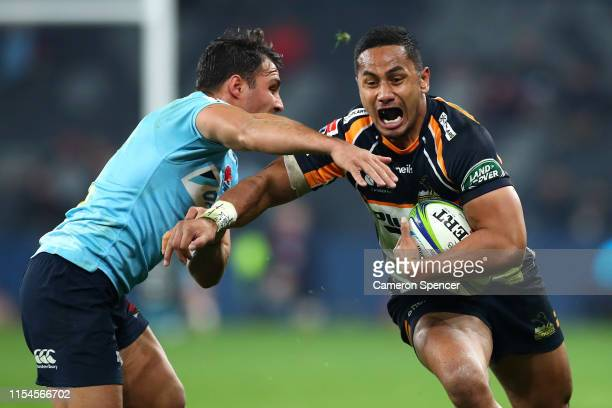 Toni Pulu of the Brumbies is tackled during the round 17 Super Rugby match between the Waratahs and the Brumbies at Bankwest Stadium on June 08, 2019...