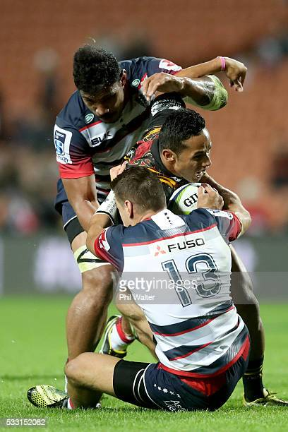 Toni Pulu of the Chiefs is tackled by Mitch Inman of the Rebels during the round 13 Super Rugby match between the Chiefs and the Rebels at FMG...